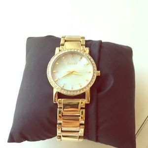 DKNY gold watch with gold pave face. NWOT
